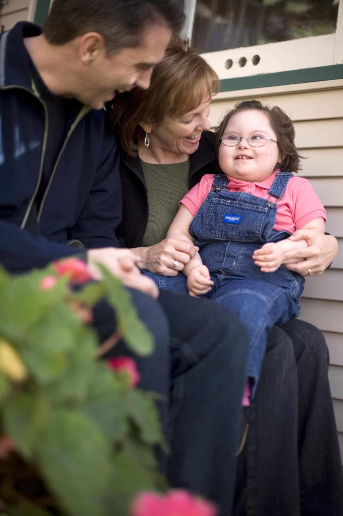 Tori smiling at parents Art and Brenda